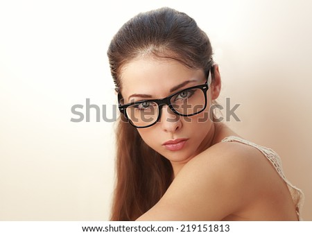 Beautiful sexy young woman in fashion glasses. Closeup - stock photo