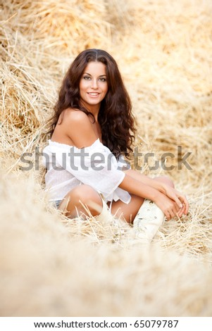 Beautiful sexy young woman in the hay - stock photo
