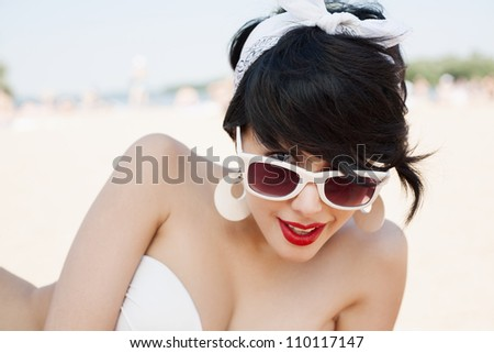 Beautiful sexy young woman relaxing on the beach - outdoors - stock photo