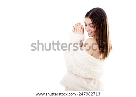 Beautiful sexy young woman taking off white bathrobe, undress exposing shoulders, isolated. Cozy, beauty, comfort, wellbeing, healthcare, bodycare, purity concepts - stock photo