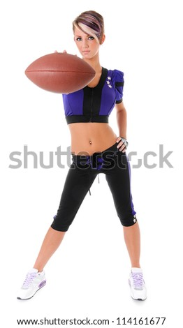 Beautiful sexy young woman wearing a pink American football Uniform - stock photo