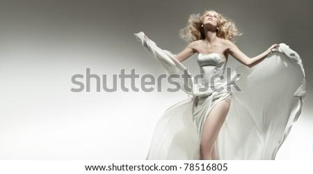 Beautiful sexy young woman wearing white dress - stock photo