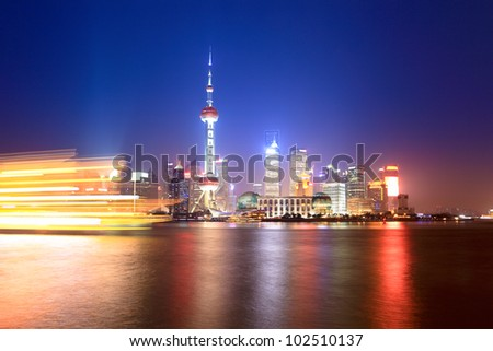beautiful shanghai huangpu river at night,light trails from pleasure boat - stock photo