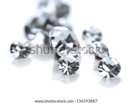 Beautiful shining crystals (diamonds), isolated on white - stock photo