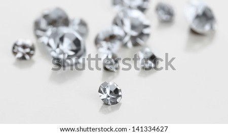 Beautiful shining crystals (diamonds), isolated on white - stock photo