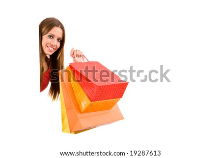 Beautiful shopping girl with bags. - stock photo