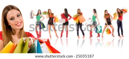 Beautiful shopping girl with bags and friends in background. - stock photo
