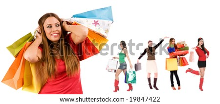 Beautiful shopping girl with colorful bags and blurred girls in background. - stock photo