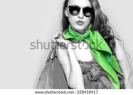 Beautiful shopping woman. black and white with green scarf - stock photo