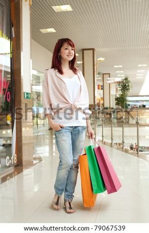 Beautiful shopping woman in mall - stock photo