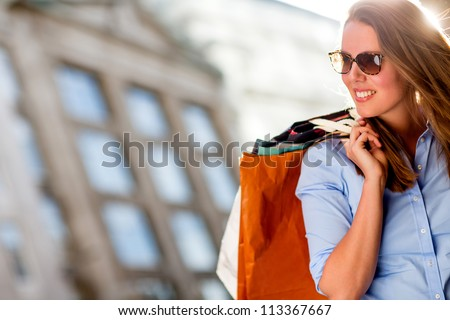 Beautiful shopping woman on a sunny summer day - stock photo