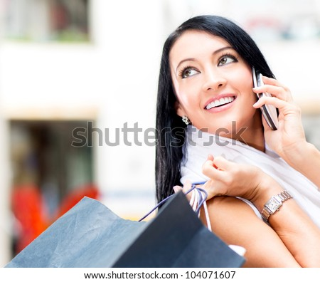 Beautiful shopping woman talking on the phone - stock photo