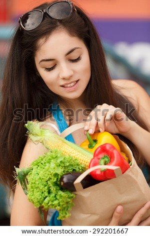 Beautiful shopping woman with vegetables, happy young girl in grocery shop with purchase bags full of organic vegetables, smiling female at supermarket buying food, instagam style filters, series - stock photo