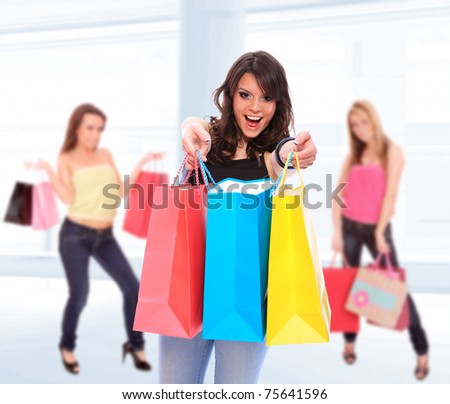 Beautiful shopping women with colorful bags - stock photo