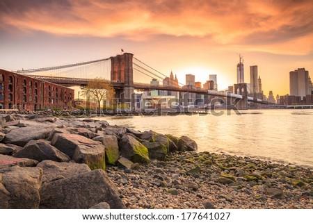Beautiful shot of Brooklyn Bridge at sunset - stock photo