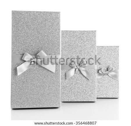 Beautiful silver Christmas gifts  isolated on white background - stock photo