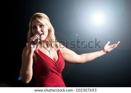 Beautiful singer with microphone - stock photo