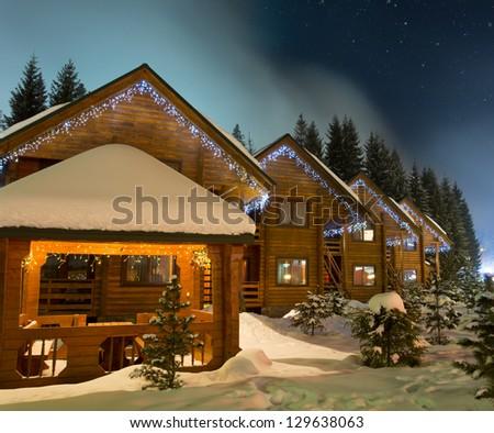 Beautiful ski chalets at night - stock photo