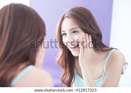 Beautiful skin care woman smile and look mirror. asian beauty - stock photo
