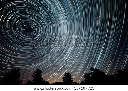 beautiful sky at night with startrails - stock photo