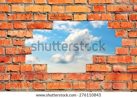 Beautiful sky over a brick wall - stock photo