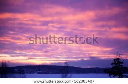 Beautiful sky, sunset landscape of a cold winter evening - stock photo