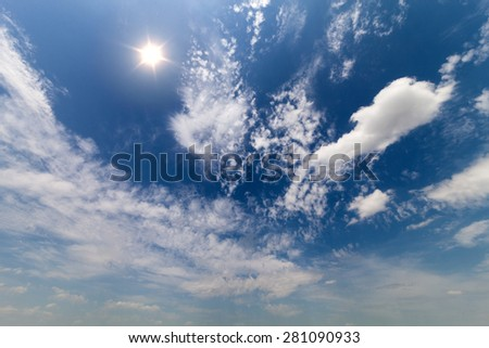 Beautiful sky with bright sun and clouds. The concept of peace and tranquility - stock photo
