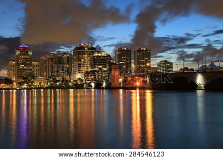 Beautiful skyline of West Palm Beach, Florida at night, as seen from Palm Beach - stock photo