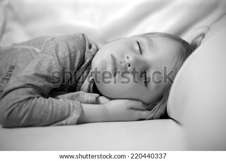 Beautiful sleeping boy,monochrome - stock photo