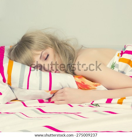 beautiful sleeping girl in the bed. beauty woman in the morning.wake-up - stock photo