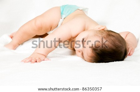 Beautiful sleeping newborn on white background - stock photo