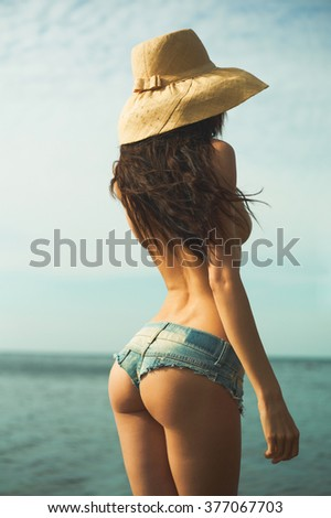 Beautiful slender lady at the sea. Summer travel photos - stock photo