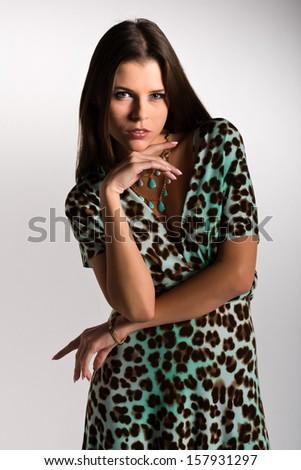 Beautiful slender Ukrainian woman in a leopard print dress - stock photo