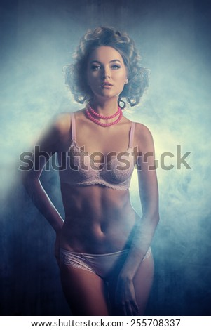 Beautiful slender young woman alluring in sexual lingerie.  - stock photo