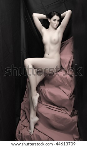 Beautiful slenderness young woman on pink background. Low key studio shot. Great for calendar and Valentine advertising. - stock photo