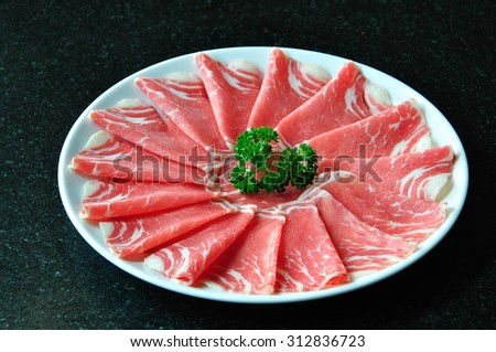 Beautiful slice meat on white plate - stock photo