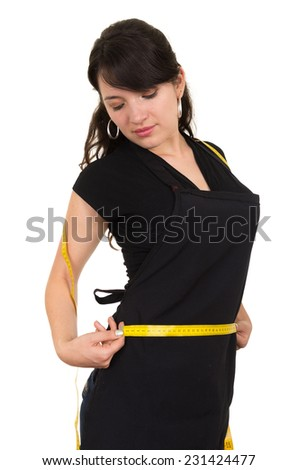 beautiful slim fit young girl holding measuring tape around her waist concept of dieting health weightloss isolated on white - stock photo