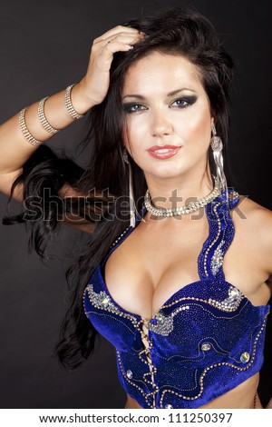 beautiful slim girl belly dancer sexy arabian turkish oriental professional artist in carnival shining costume with long healthy glossy hair. brunette woman dancing. exotic star of bellydance - stock photo