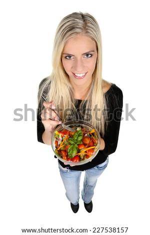 Beautiful slim girl eating fresh salad - isolated on white - stock photo