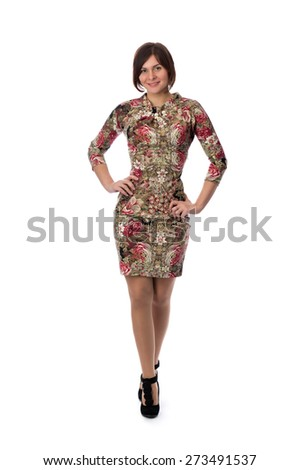 Beautiful slim girl in a dress with a pattern to his full height. Studio, isolate on white. - stock photo