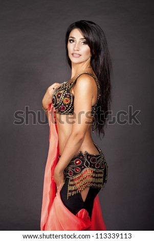 beautiful slim woman belly dancer. sexy arabian oriental professional artist in carnival shining costume with long healthy glossy hair. exotic star of bellydance. dancing girl brunette - stock photo