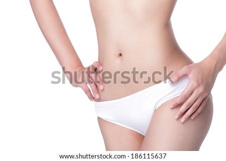 Beautiful slim woman body isolated on white background - stock photo