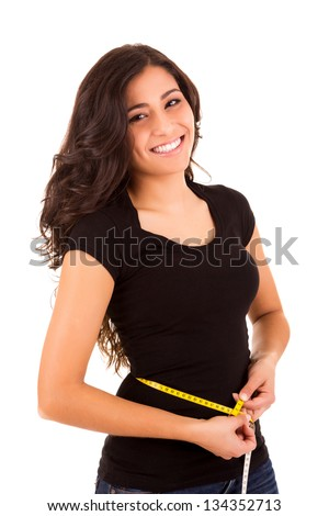 Beautiful slim woman measuring her body with a measuring tape - stock photo