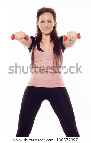 Beautiful slim woman with dumbbells - stock photo