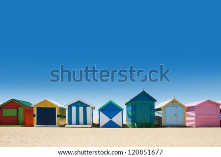 Beautiful small bathing houses on white sandy beach at Brighton Beach, Australia - stock photo