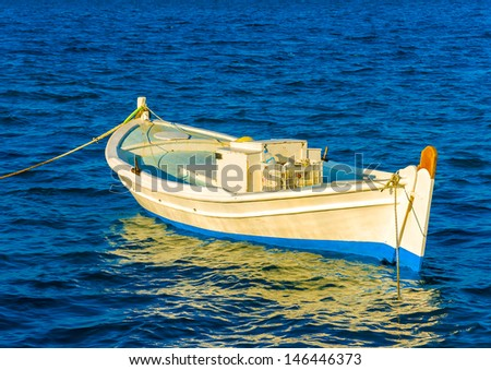 Beautiful small fishing wooden old boat located in Nafplio town in Greece - stock photo