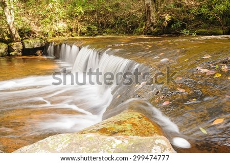 Beautiful small mountain brook in tropical forest, Thailand. - stock photo