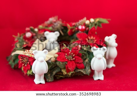 beautiful small plaster bear wishes Merry Christmas, Red background - stock photo