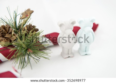 beautiful small plaster bear wishes Merry Christmas. White background - stock photo