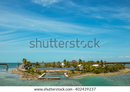 Beautiful small private island with a private bridge located in the Atlantic ocean between Miami and Key West - stock photo